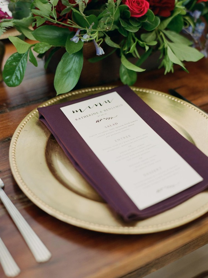 gold and burgundy wedding place setting