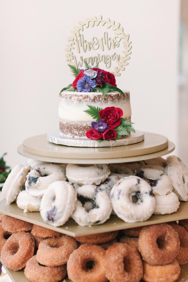 mini wedding cake on a tower of donuts