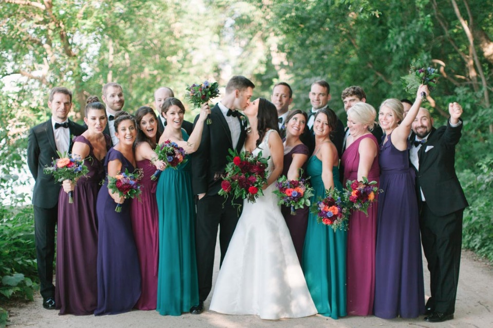 wedding party in jewel tones and tuxedos
