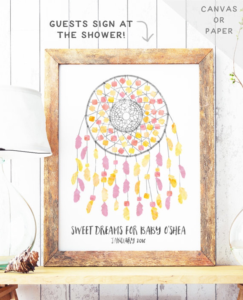 Miss Design Berry's boho baby shower guest book features a bohemian watercolor dreamcatcher with spots for all of the guests to sign