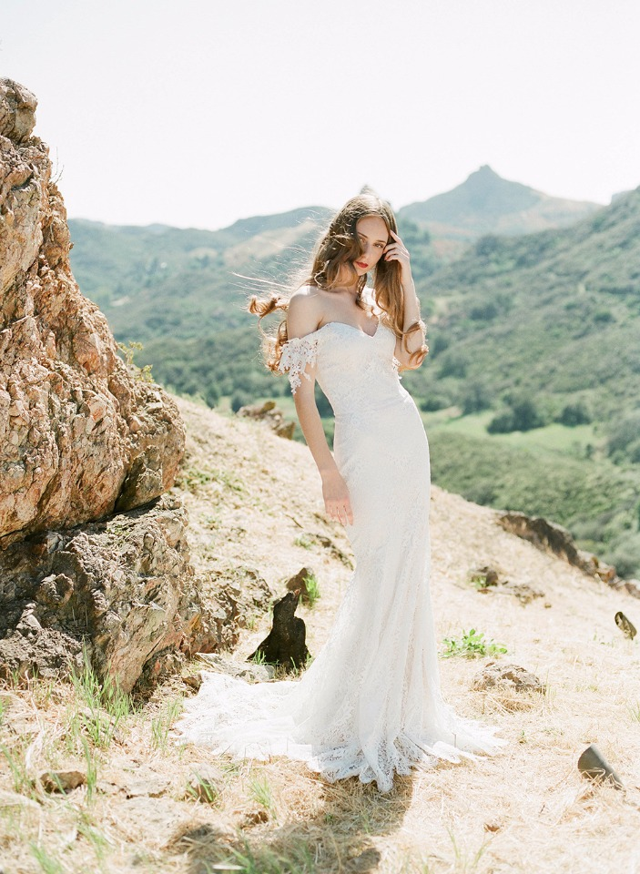 off the shoulder lace wedding gown made with Guipure lace