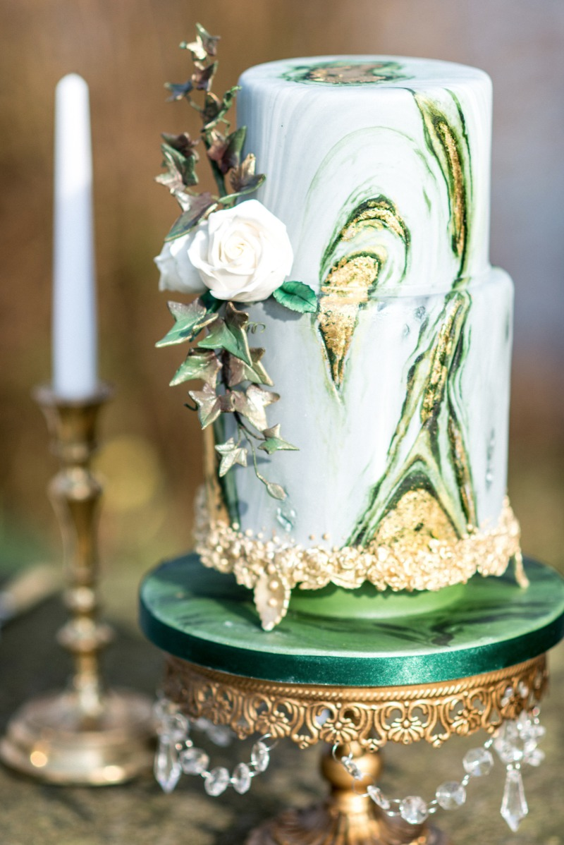 Green Marbled Tiered Wedding Cake on Opulent Treasures Gold Chandelier Cake Stand