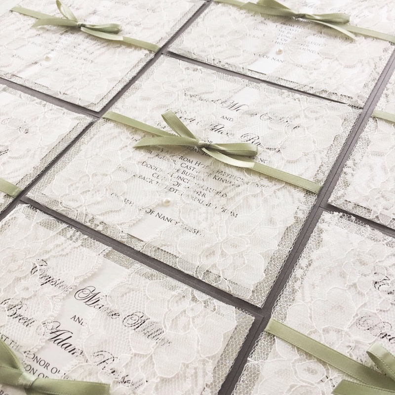 Elegant lace invitations with olive ribbon and lace doors. The pearls just add the cherry on top!