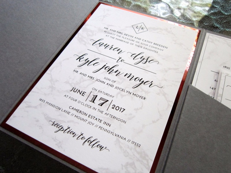 Marbled invitation suite with copper foil layer created exclusively by Persnickety Invitation Studio.