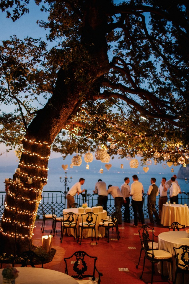 romantic twinkle lights and lanterns hung in the trees