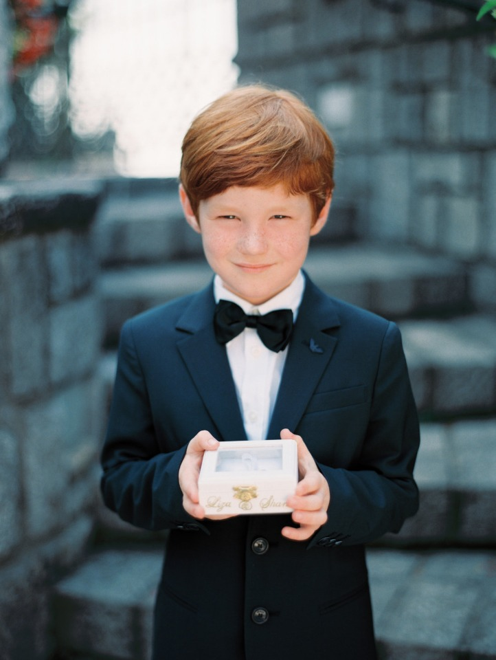 ring bearer in suit and bow tie