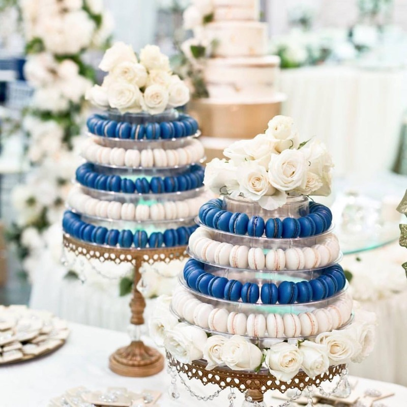 Macaron Tower with a little something blue for your wedding cake table! Gold chandelier dessert stand by Opulent Treasures