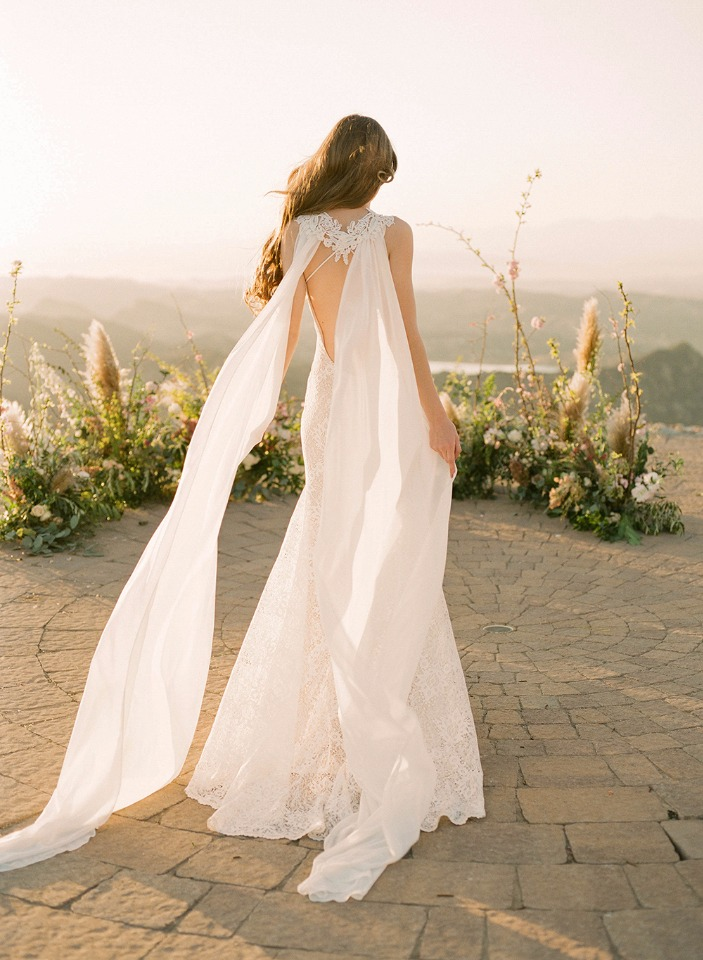 detachable cape on this lace wedding gown from Claire Pettibone
