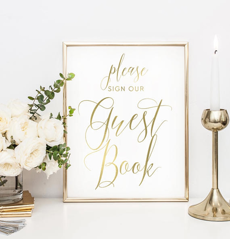 Miss Design Berry's Gold and White Please Sign Our Guestbook sign features dynamic type for an elegant yet modern look, perfect for