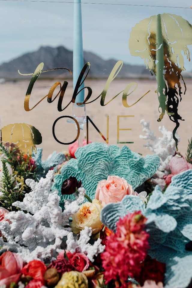 clear and gold table number sign