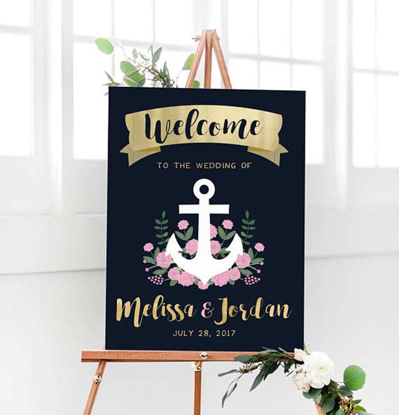 Miss Design Berry's Navy & Gold Nautical Anchor Welcome Sign features dynamic type for an elegant yet modern look, perfect for