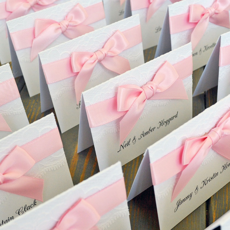 Finishing up the cutest place cards. Your guests will love the lace detail and pink ribbon!