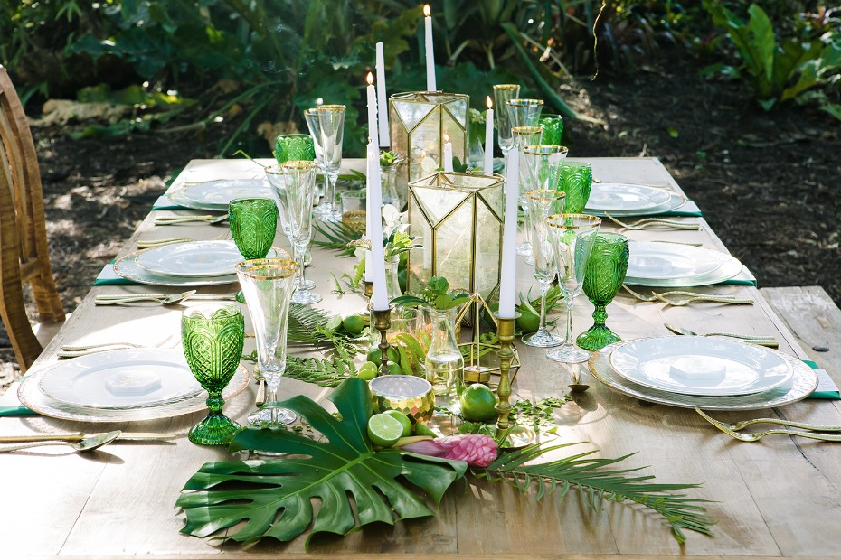green and gold wedding table with a tropical vibe