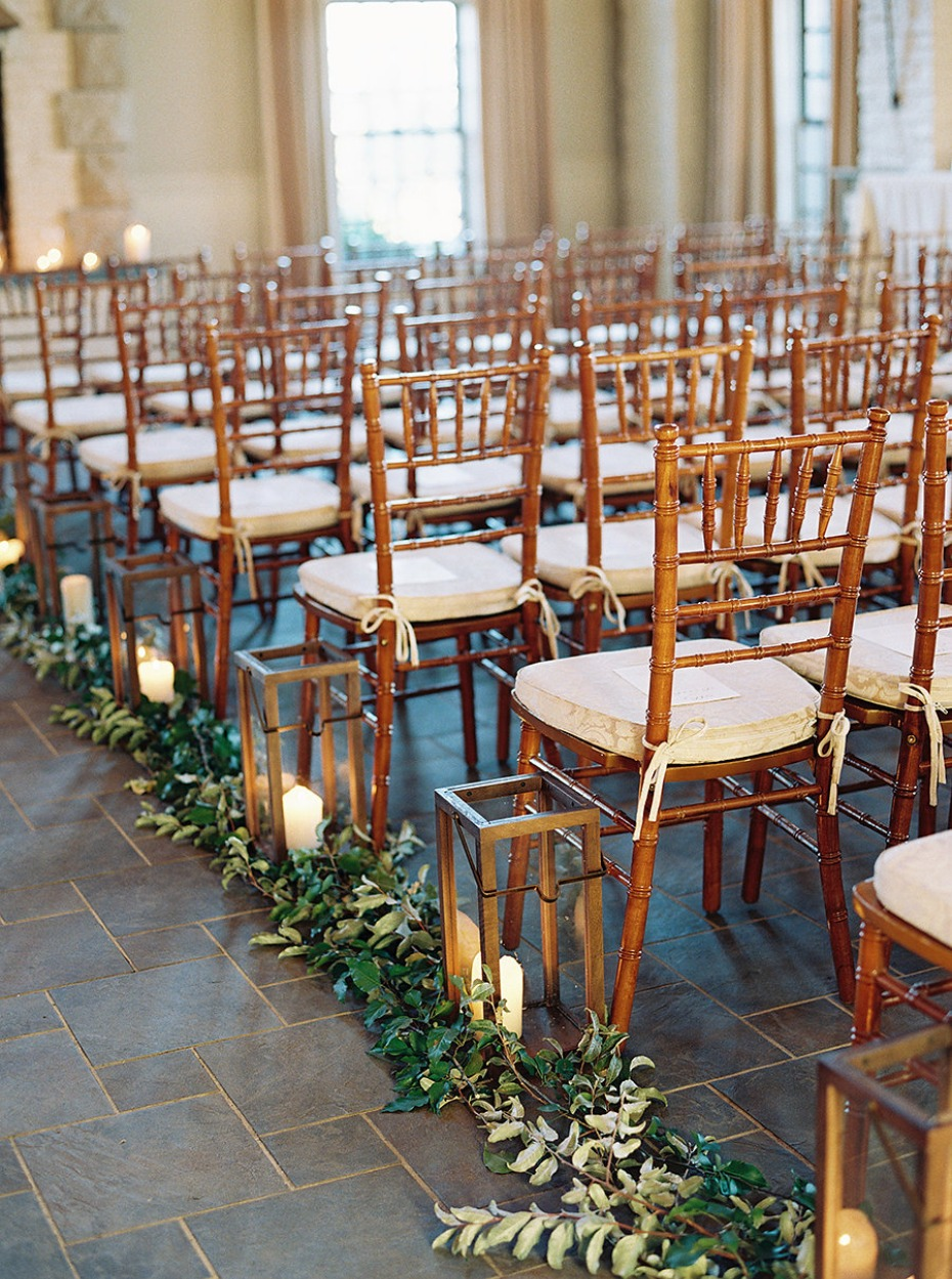 Romantic ceremony with greenery and candlelight