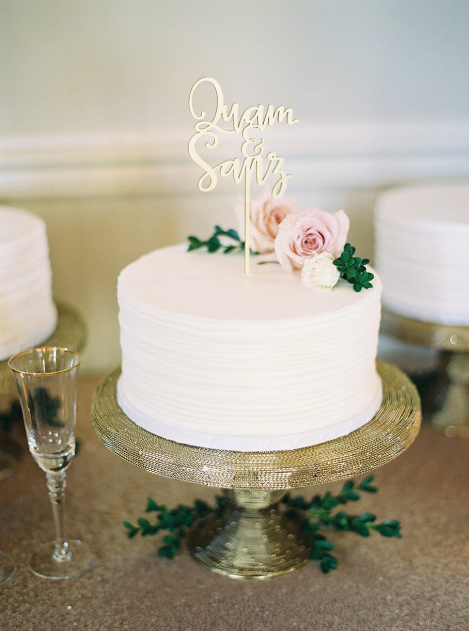White wedding cake with gold topper