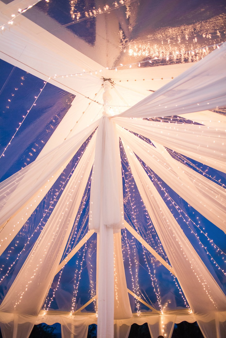 Lighting and drapery ideas for a tent wedding