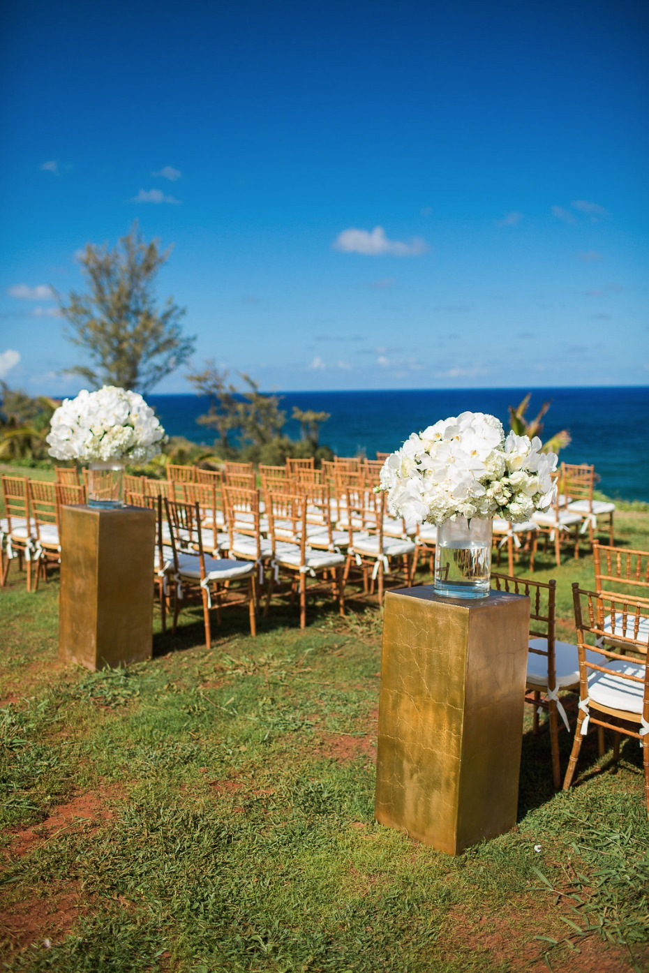 Gold and white ocean view ceremony