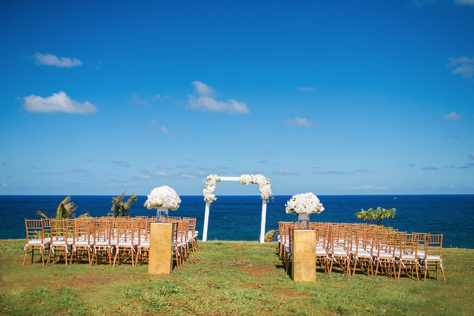 Dreamy gold and white ocean view ceremony