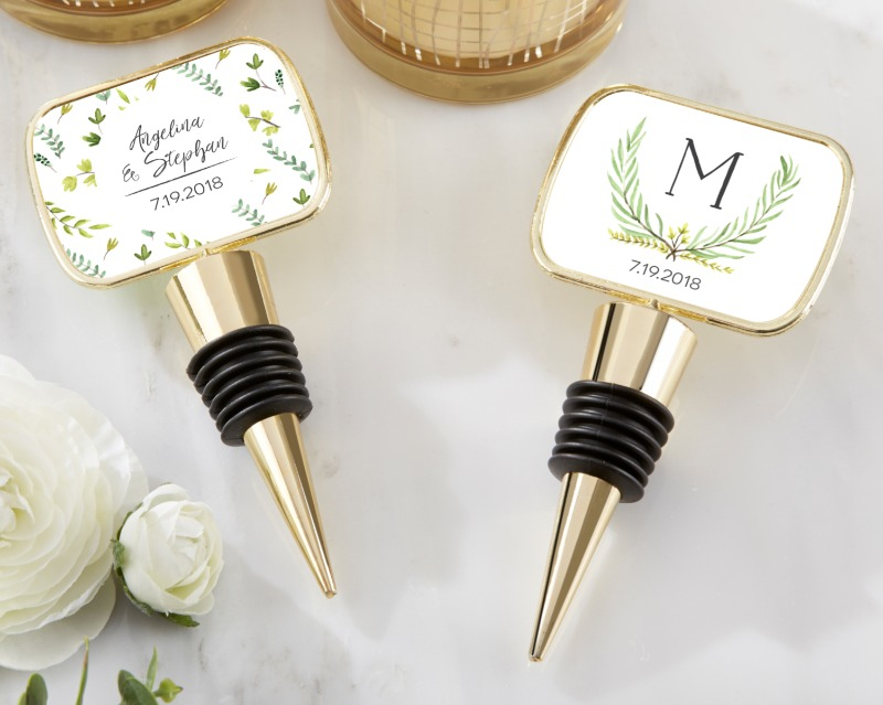 Featuring your names, monogram or wedding date on a botanical garden sticker under the protective epoxy dome, these garden bottle stopper