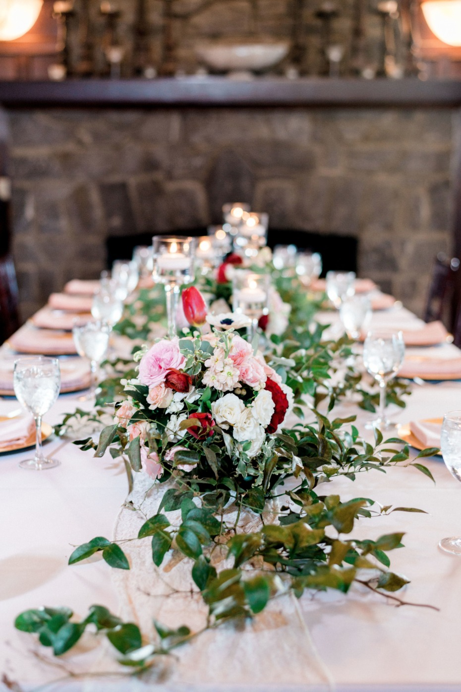 ivy garland and pink and red floral centerpiece
