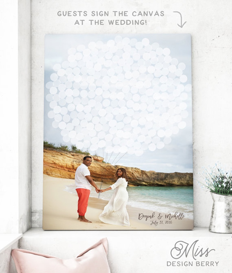 Miss Design Berry's canvas guest book alternative features your engagement photo with balloons illustrated on top for guest signatures