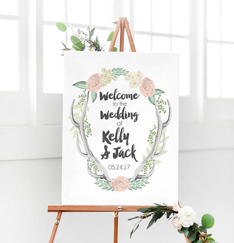 Miss Design Berry's Rustic Antler Wedding Welcome Sign features dynamic type for a rustic yet modern look, perfect for your rustic