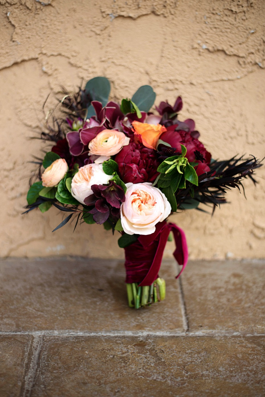 deep red and peach bridal bouquet