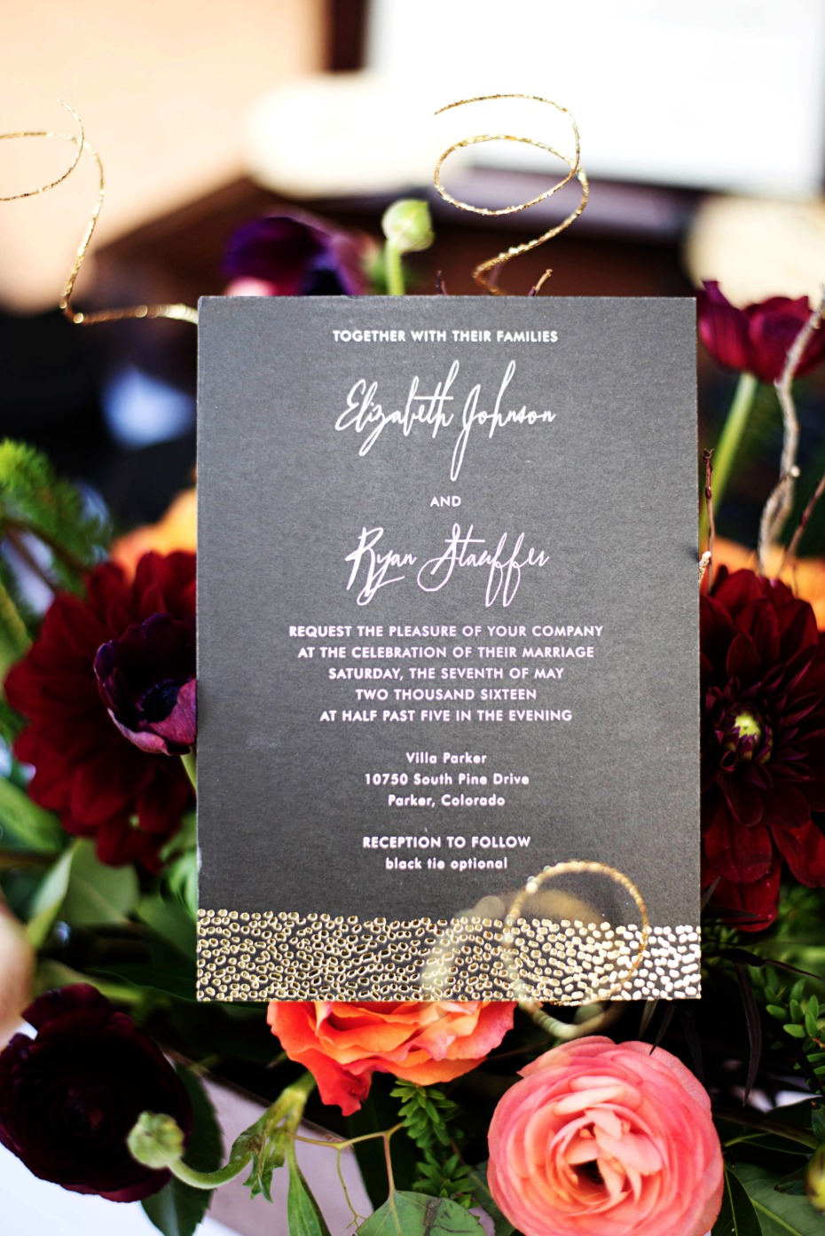 wedding invitation in black and gold
