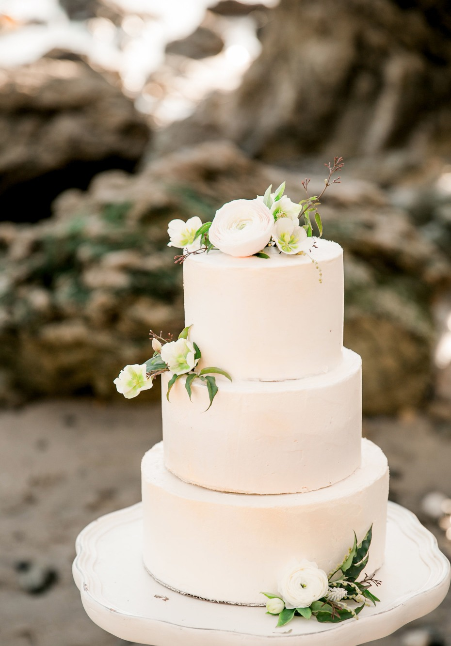 modern chic wedding cake topped with flowers