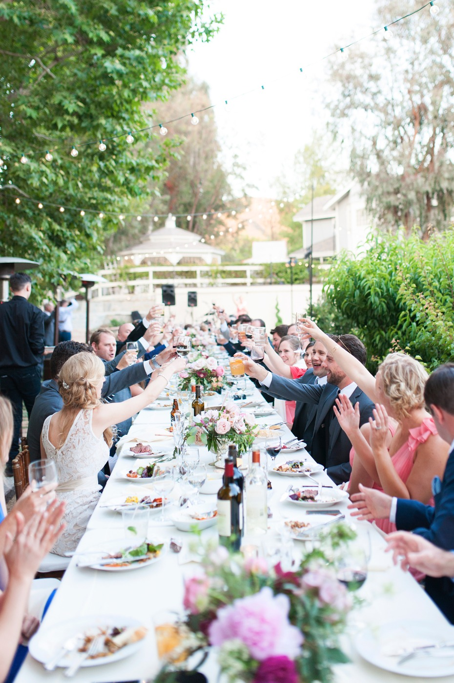 Toast to the newlyweds at this chic garden wedding