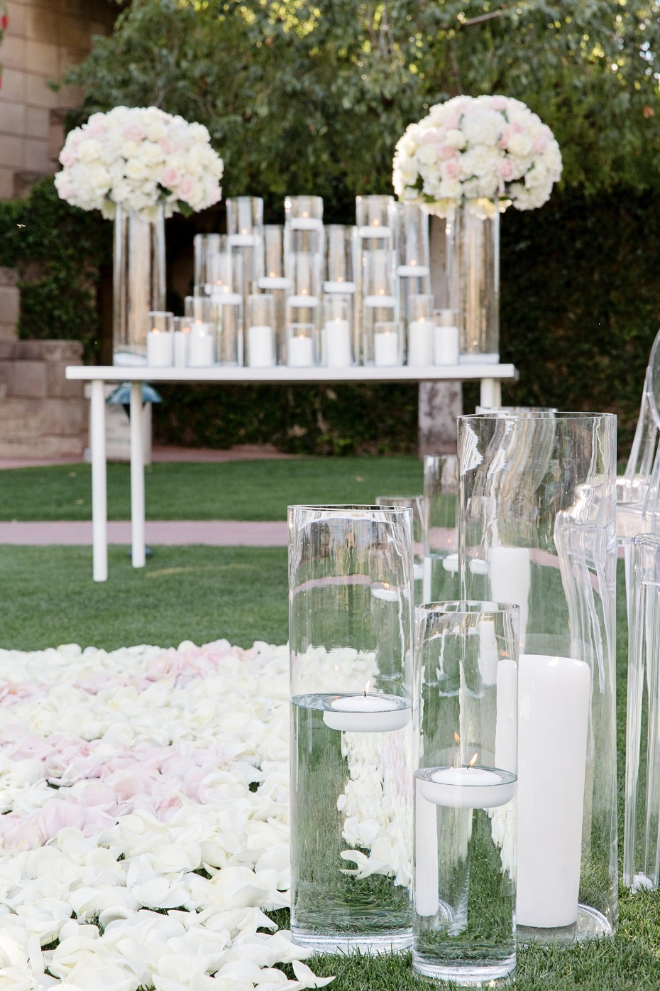 flower petal and floating candle ceremony decor