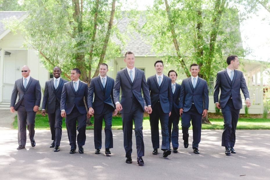 groom and his men in matching charcoal grey suits