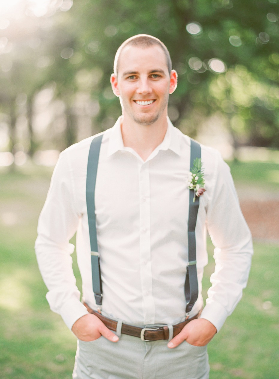 Laid back groom look with suspenders