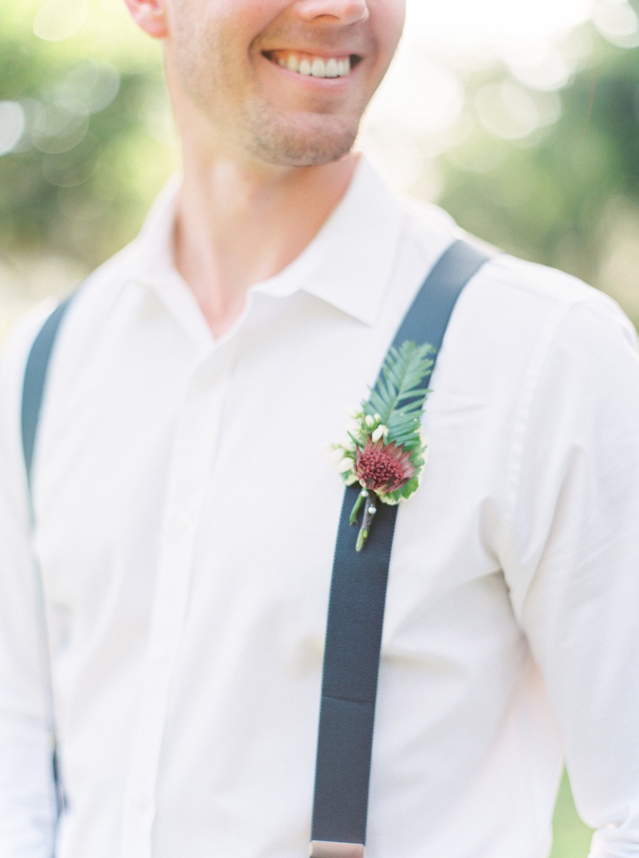 Greenery boutonniere and suspenders