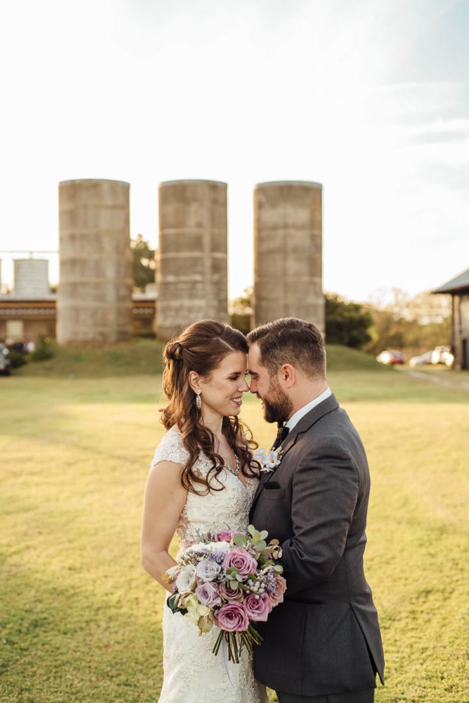 Green and purple fall outdoor wedding amongst the silos