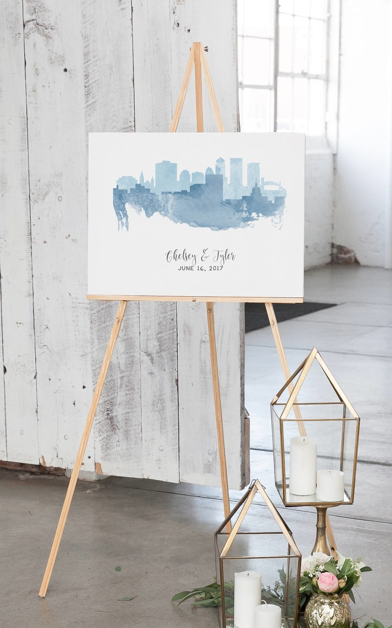 Miss Design Berry's fun wedding guest book alternative features two skylines of your choice, in the colors of your choice!