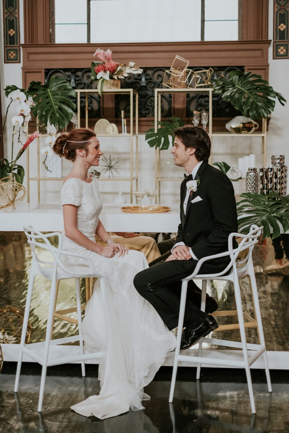 Bride and groom looks at this tropical glam wedding