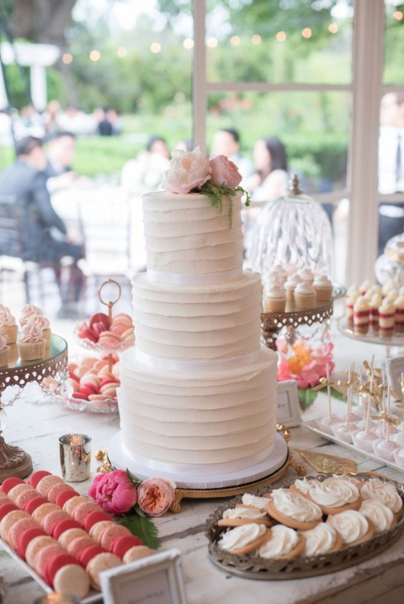 Gorgeous Wedding Cake Table with mini cupcakes, macarons & cookies on Opulent Treasures Gold Chandelier Dessert stands