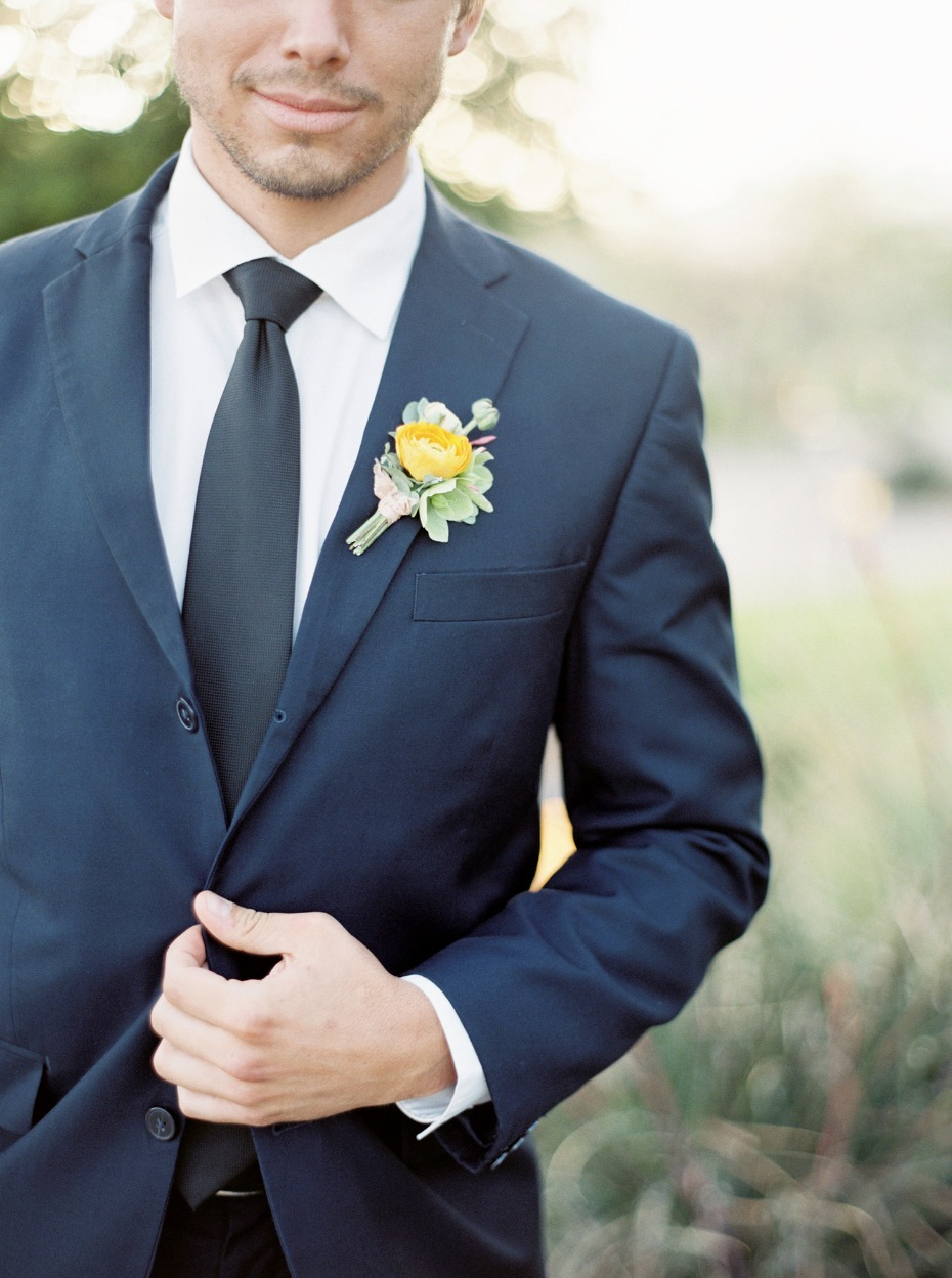 Navy suit and yellow boutonniere
