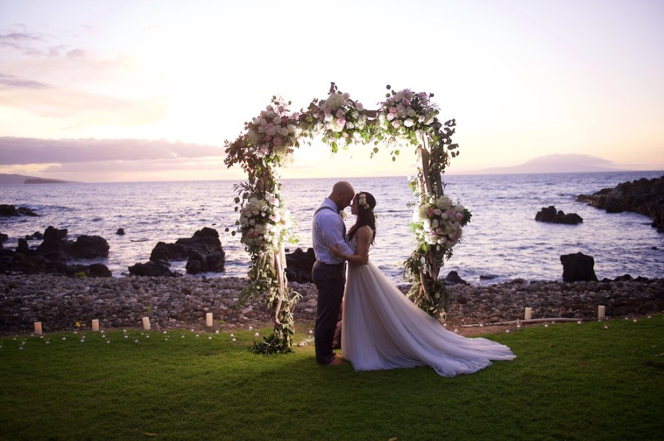glowing wedding arch at sunset