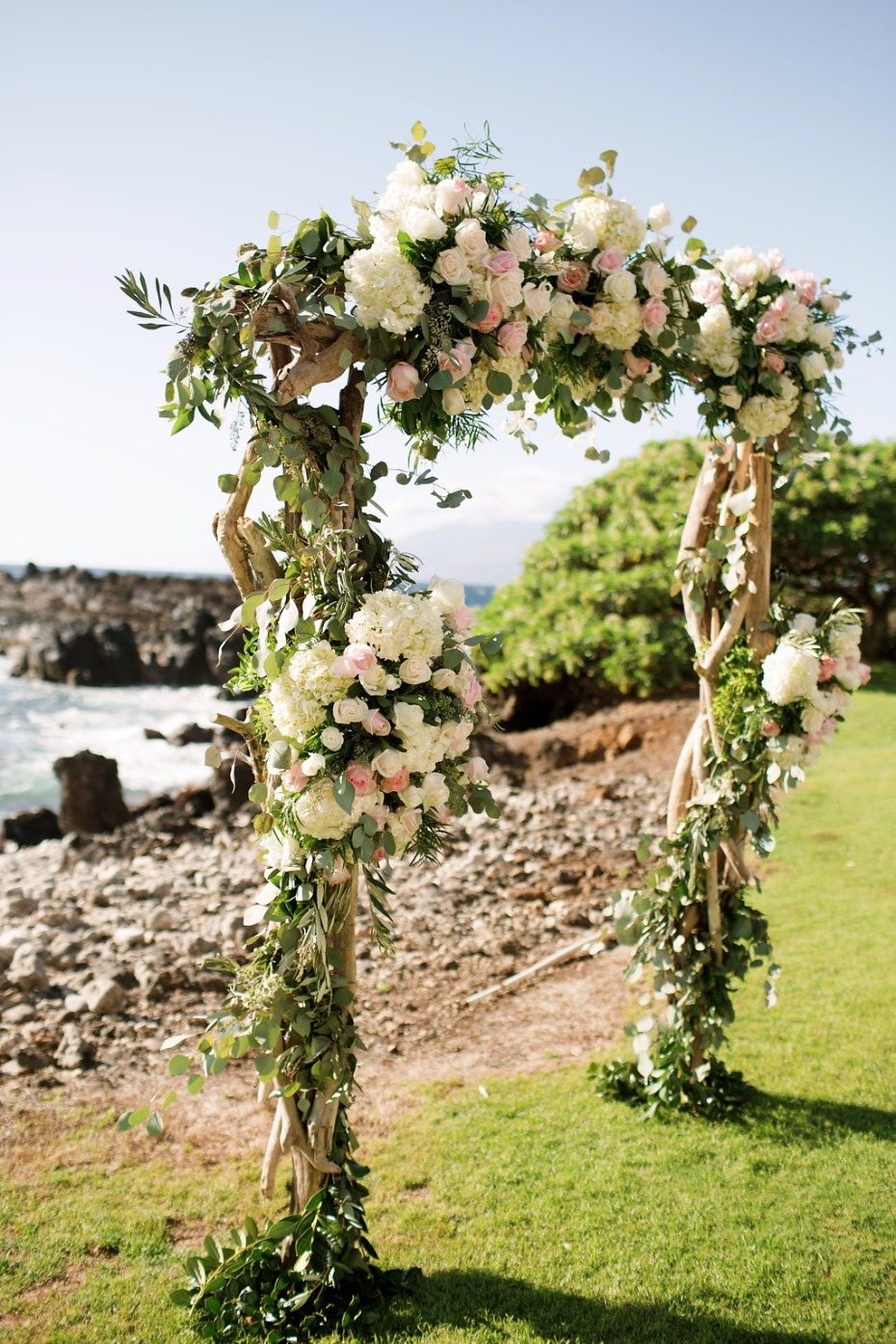 pink and white floral wedding arch