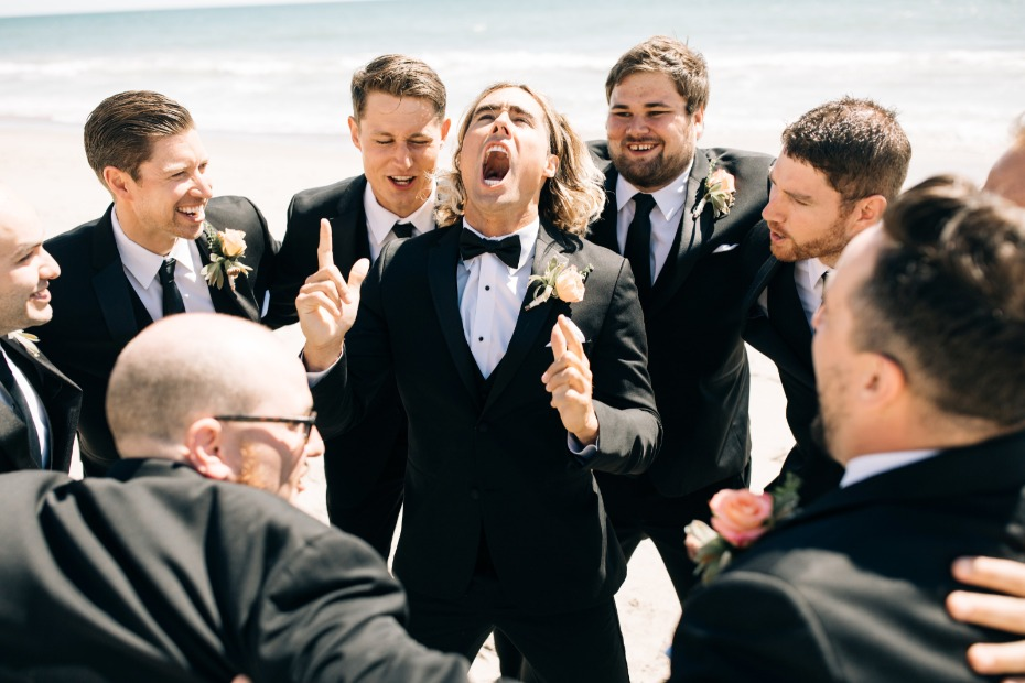 groomsmen getting pumped for the big wedding ceremony