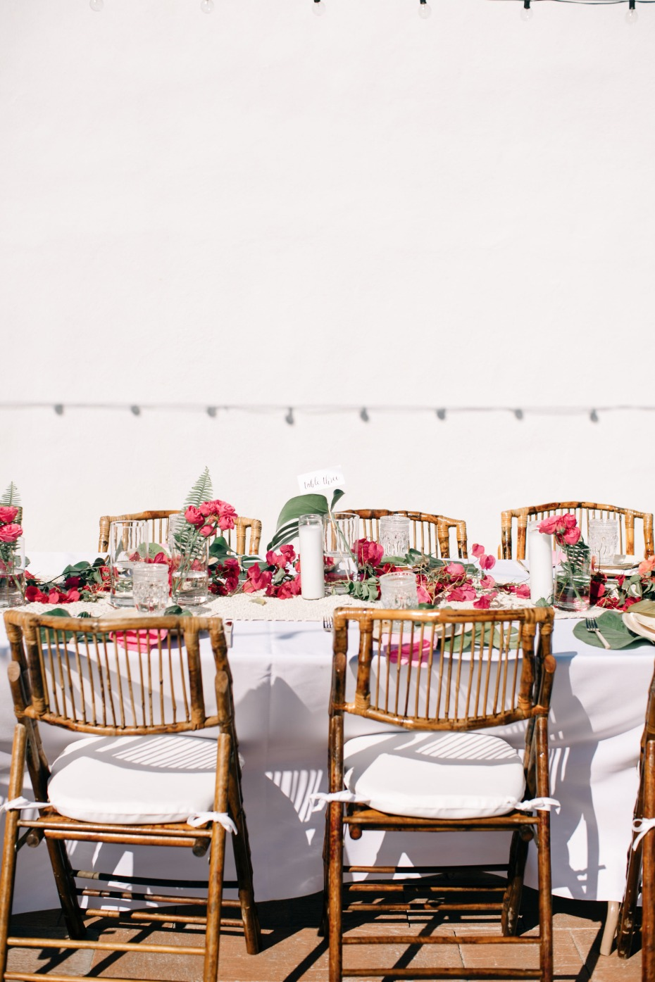 tropical boho wedding reception in magenta and white