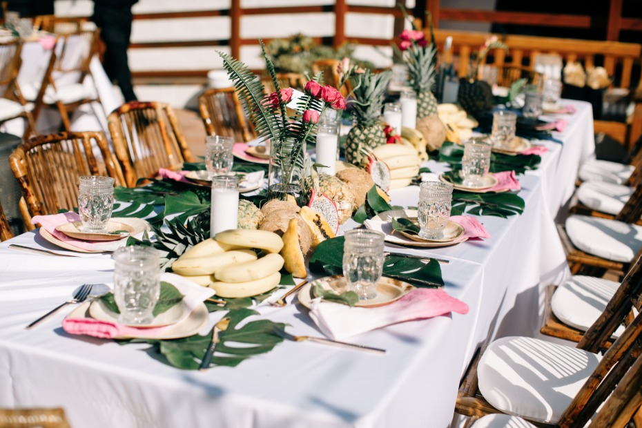 fresh fruit was spread across the table at this wedding