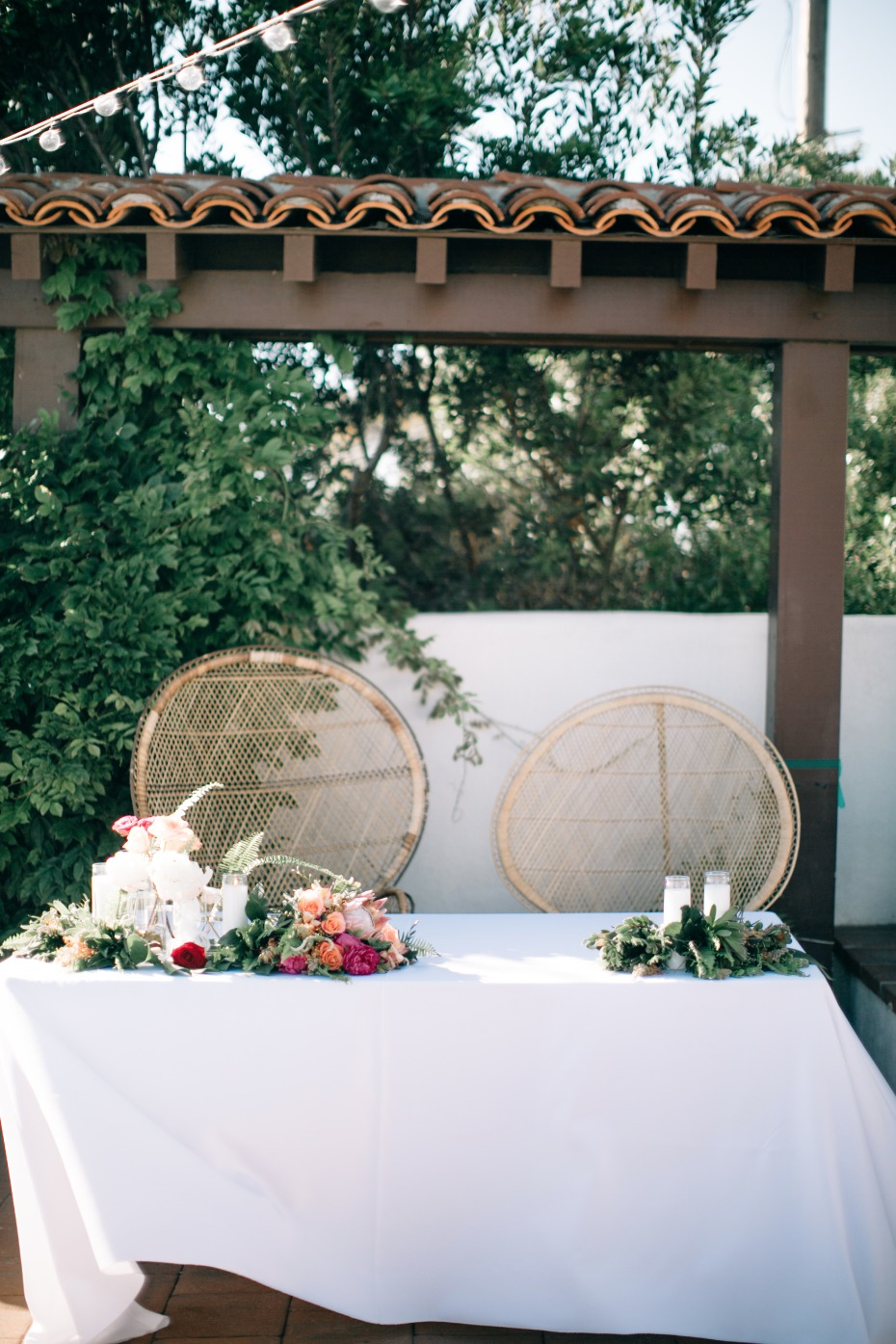 Peacock wedding chairs at sweetheart table