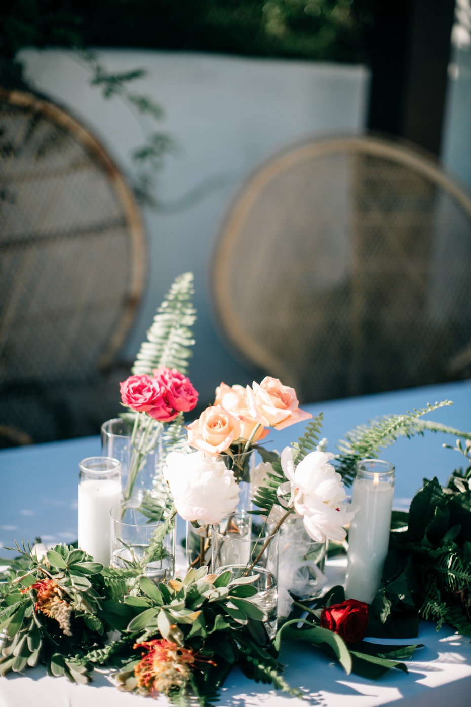 single stem florals placed in glass