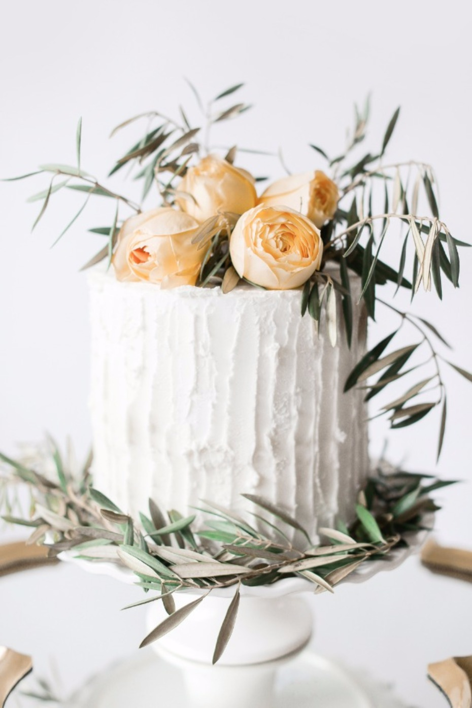 DIY foliage cake topper with leftover bouquet flowers