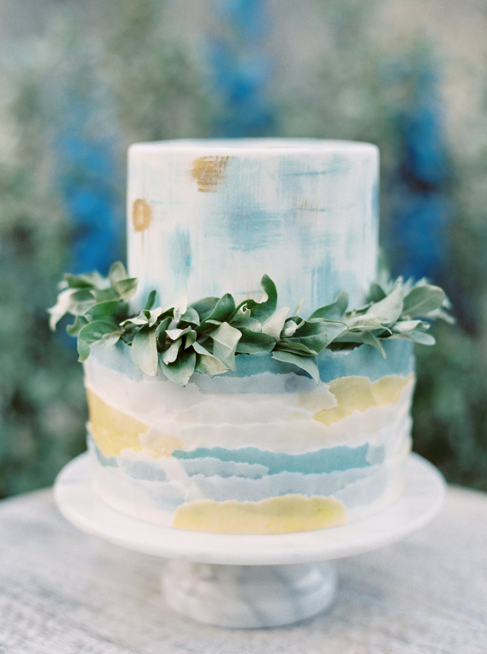 gold and blue watercolor wedding cake