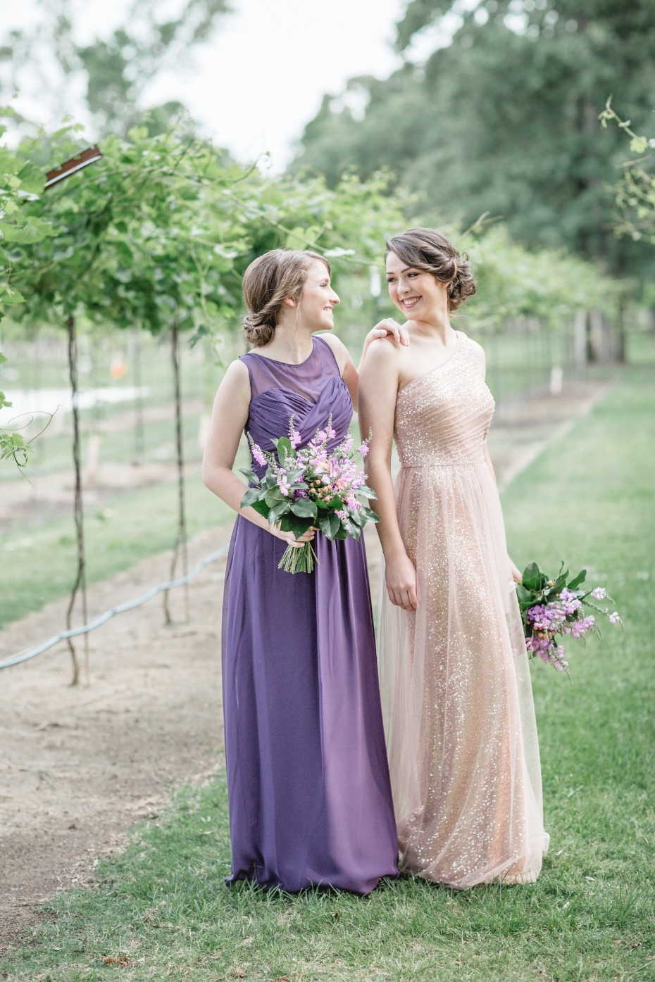 bridesmaids in purple and champagne sparkles