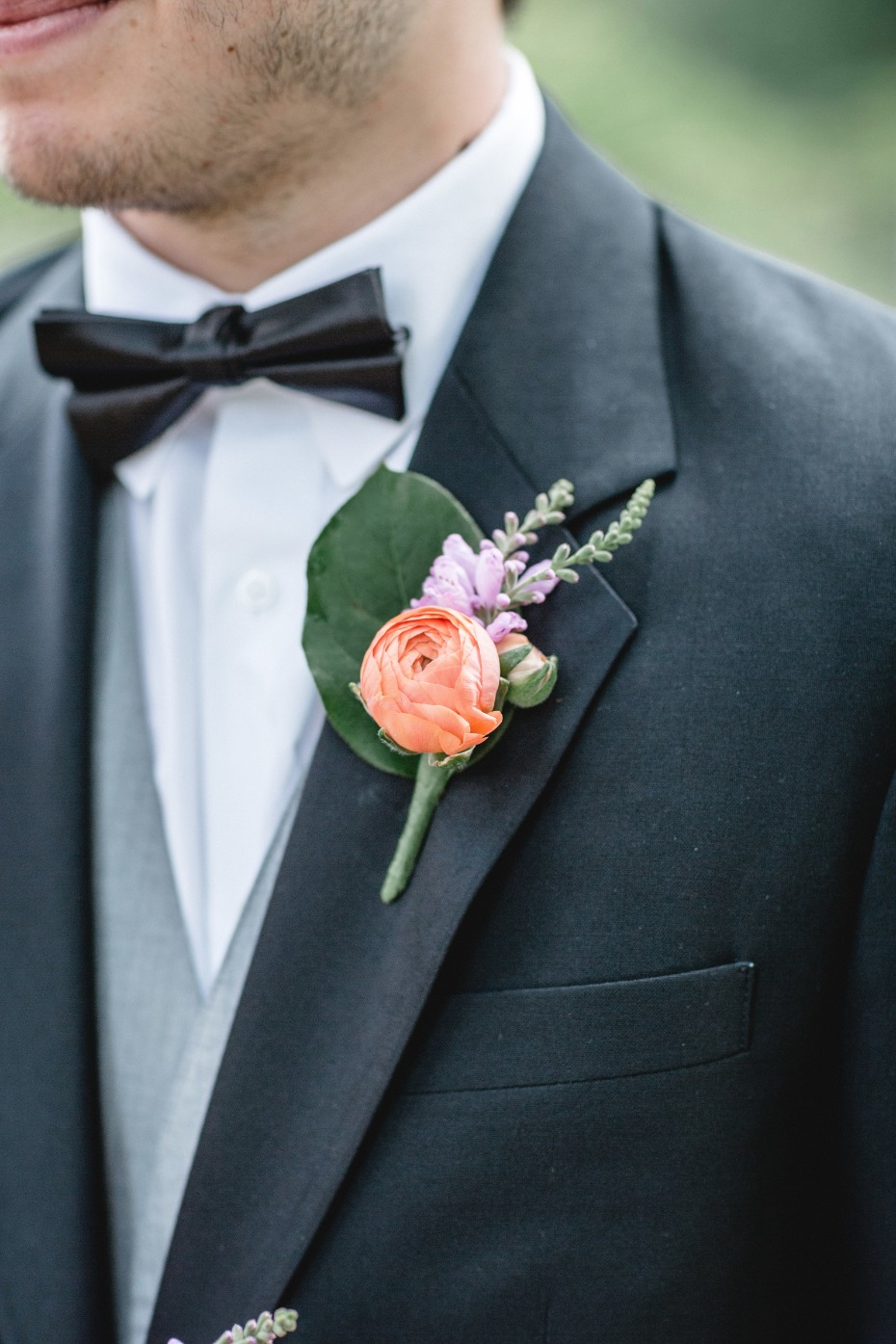 purple and orange boutonniere